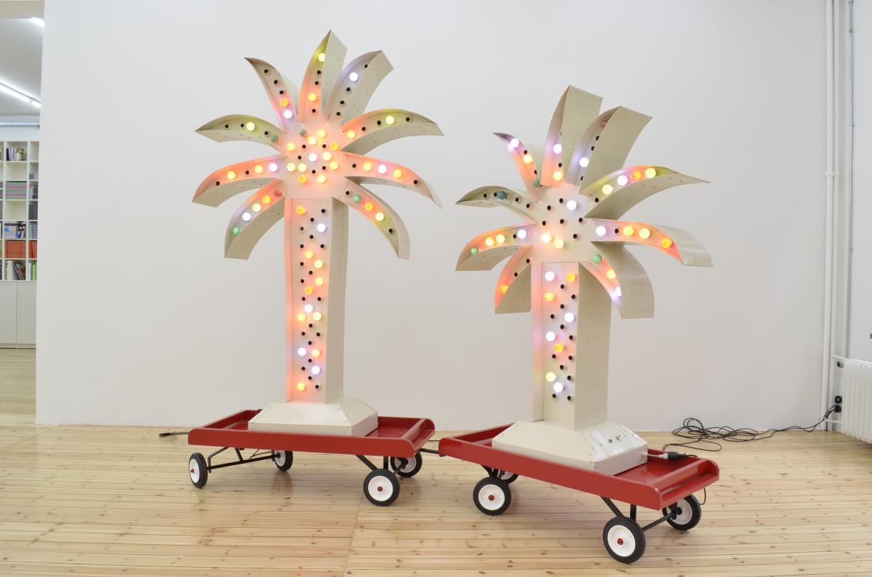 Twin Palm Island, 2012, Steel, galvanized sheet metal, colored electric bulbs, plastic and rubber wheels, 319 x 160 x 35 cm, Edition 3 + 1 AP
