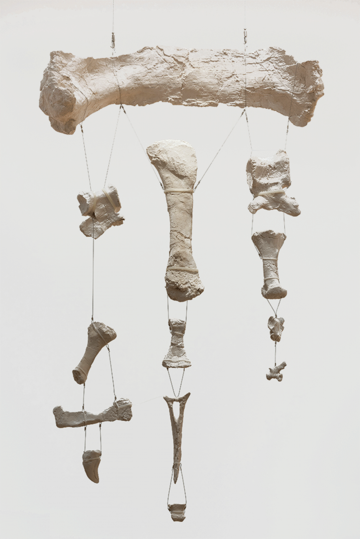 Untitled (mobile of Tazoudasaurus Naimi bone fragements from the Late Early Jurassic Period, Morocco), 2015, plaster, wire, variable dimensions