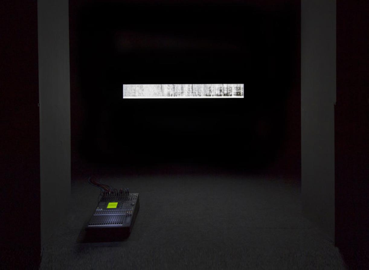 Saydnaya (the missing 19db), 2016, Installation: misking desk, loudspeaker, lightbox, Variable dimensions, Ed. 3 + 2 AP