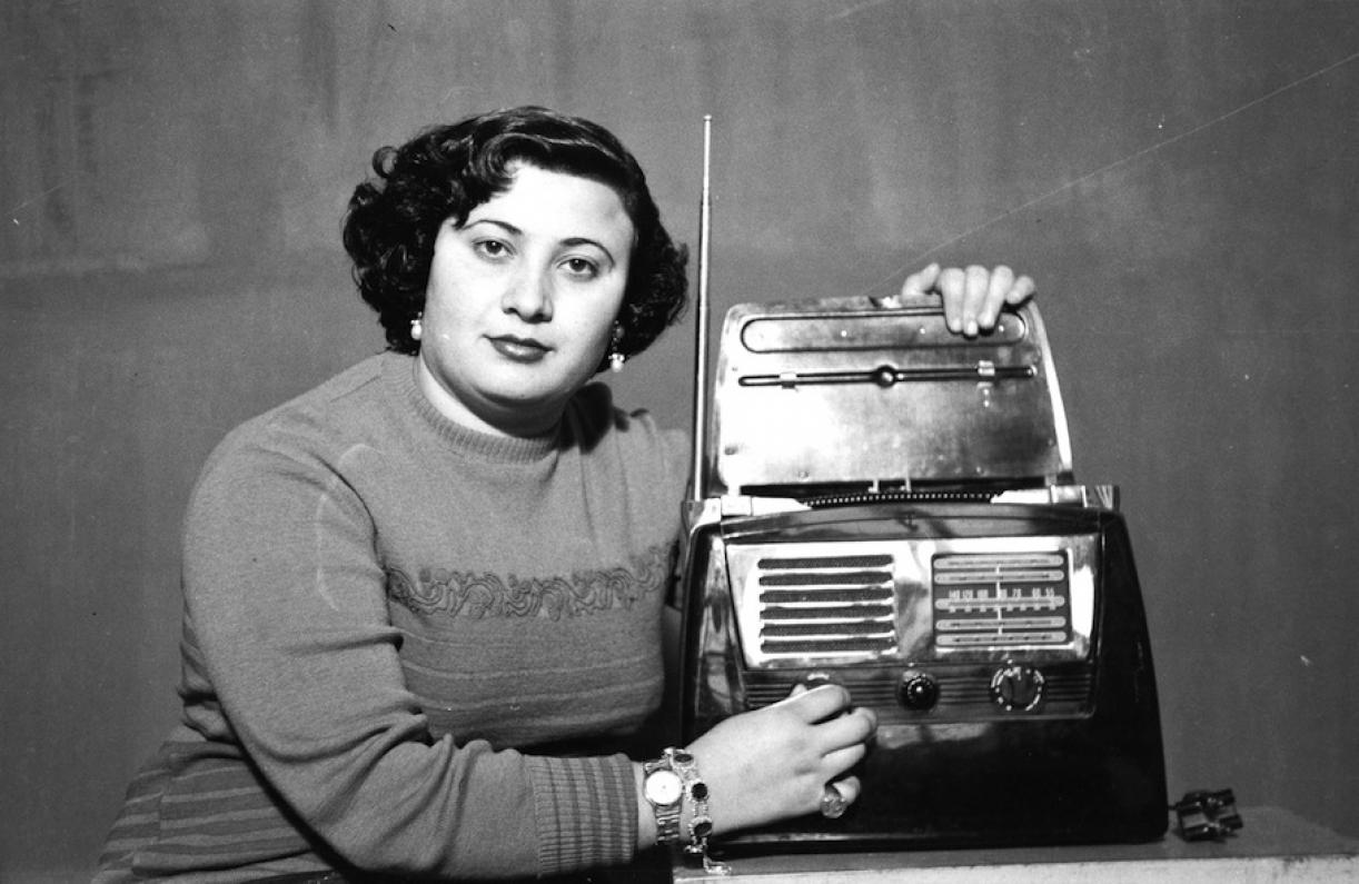 Hashem El Madani: Studio Practices, posing with radio, woman from Tyr, 1948-53, silver prints, 19 x 29 cm