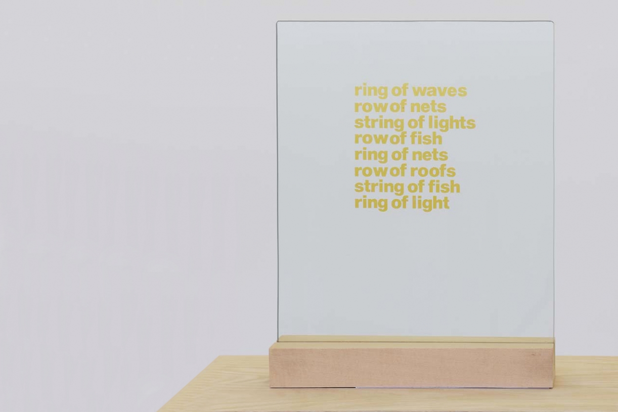 Ring of Waves, 1964, Glass with gold inscription, wooden stand, 57.5 x 17.5 x 6 cm, Unique