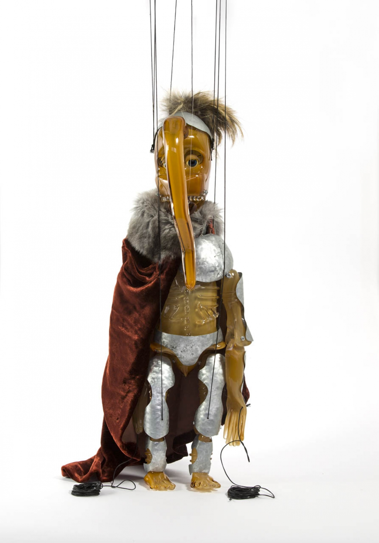 Cabaret Crusades: The Secrets of Karbalaa, Marionette (Orange soldier), Glass, fabric, enamel, thread, 51 x 16 x 13 cm