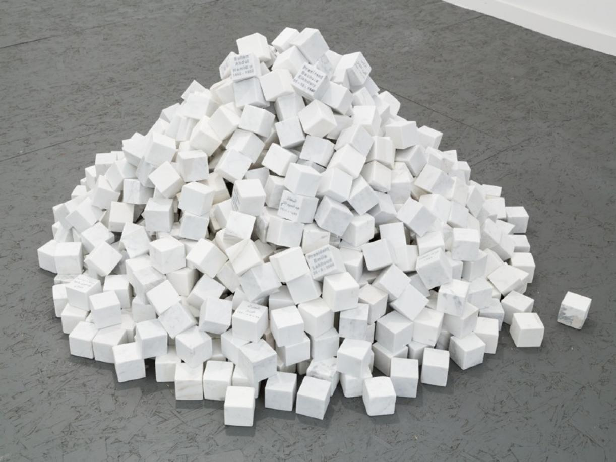 ​​​​​​Veni, Vidi, Vici, 2013, 1000 marble cubes, 13 engraved in English, 13 engraved in Arabic, each stone: 7 x 7 x 7 cm, overall dimensions: ø 160 x 80 cm, Ed. 5 + 1 AP, Permanent collection in Centre Pompidou