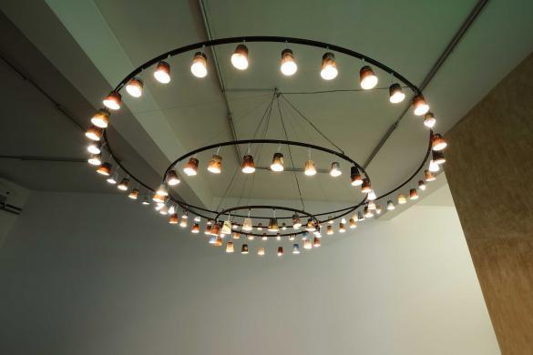 Al Nathafa Min Al Iman, 2019, Metal, wire, paper, plastic cups, & light bulbs, Diameters 3 m, 2 m, 1 m