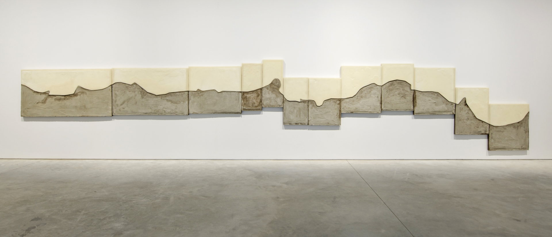 Marwan Rechmaoui, Untitled 12, 2017. Concrete, brass, beeswax, fibre mesh, Styrofoam on wood board, 200 x 1000 cm, Unique. Installation view, Sharjah Biennial 13, 2017. Commissioned by Sharjah Art Foundation. Image courtesy of Sharjah Art Foundation