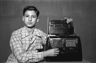Hashem El Madani: Studio Practices, posing with radio, Rawas, now a sheikh, 1948-53, silver prints, 19 x 29 cm