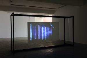 Walled Unwalled, 2018, Single-channel video, color, sound, Installation, with metal structure, glass & foil, 20 mins, Ed. 6 + 2 AP, Wall design in collaboration with Müller Aprahamian