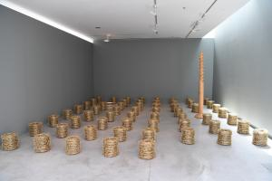 Area C Fields of Gold (Not everything that shines is Gold), 2017, 60 metal barbed wire coils, metal, paint, diameter 40 x 30 cm each. Installation view, Sharjah Art Foundation